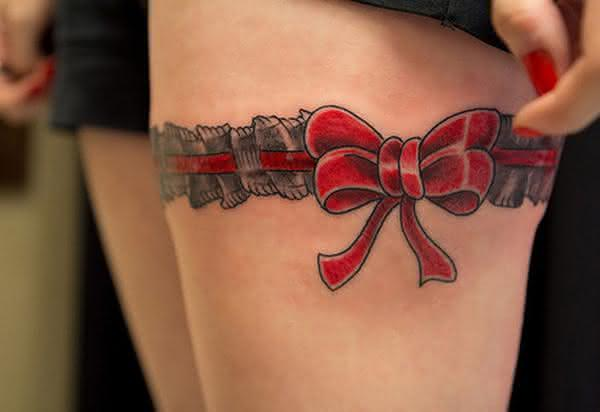 10-Red-Ribbon-Tattoo-on-thigh