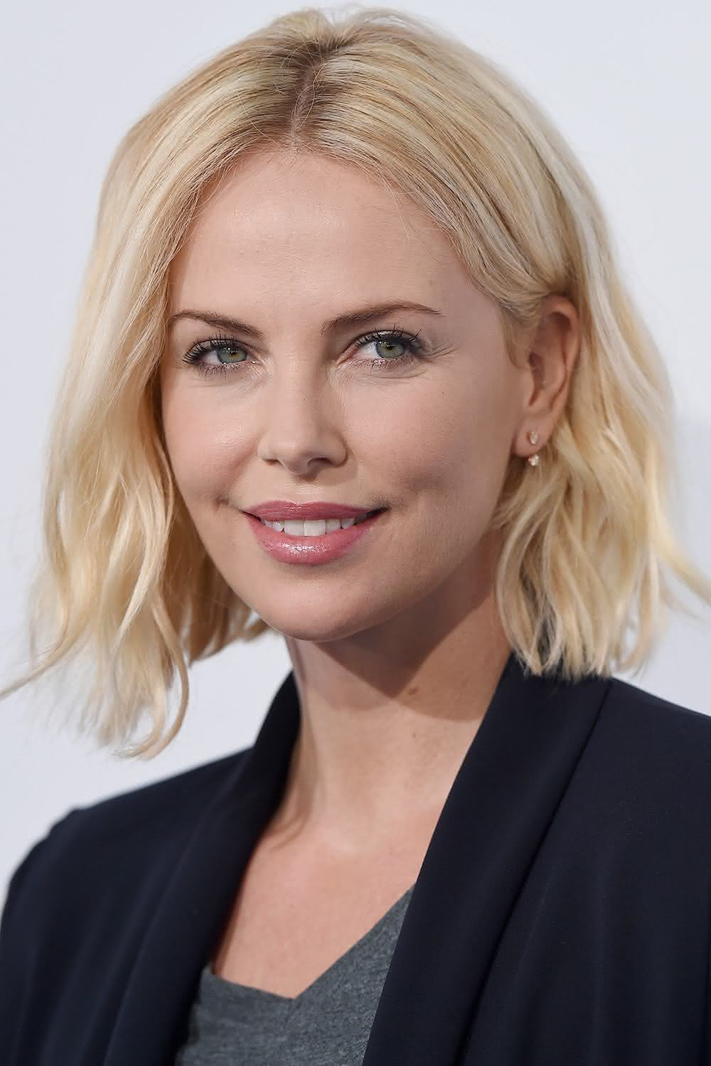 INGLEWOOD, CA - APRIL 07: Actress Charlize Theron arrives at WE Day California at The Forum on April 7, 2016 in Inglewood, California. (Photo by Axelle/Bauer-Griffin/FilmMagic)